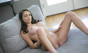Teen solo girl Ashly Anderson unveils her nice tits as she gets naked on sofa
