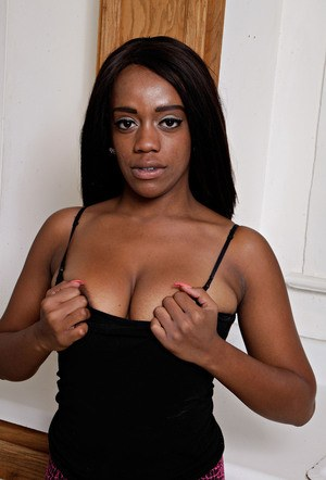 Black chick Amber Cream pulls out her big boobs then finishes disrobing