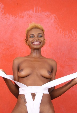 Ebony amateur removes her barely there clothes prior to showing her pink pussy