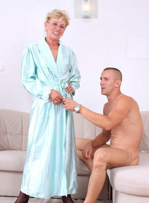 Older lady greets her boy toy for sex in her lingerie and a robe