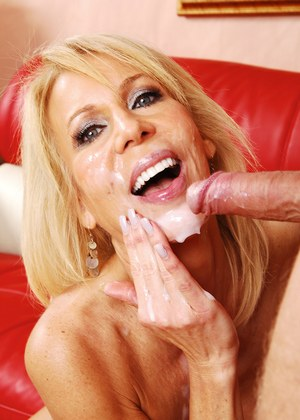 Older blond woman Erica Lauren gives the thumbs up after fucking a younger guy