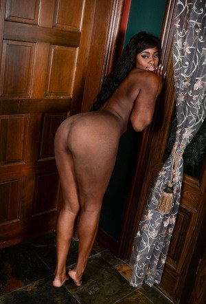 African female Camille Amore flaunts her big butt before showing her pink twat