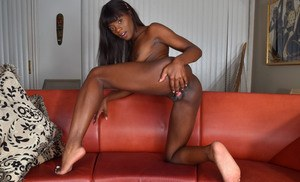 Leggy black babe Ana Foxxx spreads her pussy wide open after disrobing