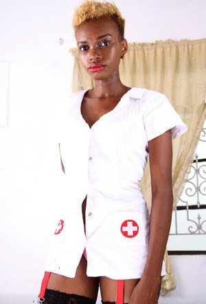 Black nurse removes her uniform to display her twat in stockings only