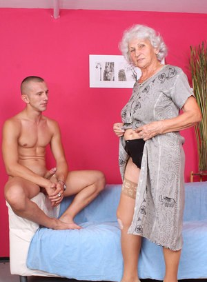 Overweight grandmother strips to tan stockings before fucking her boy toy