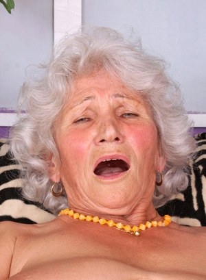 Fat granny strips to her stockings prior to fingering her horny vagina
