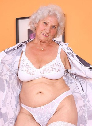 Fat grandmother sucks on her fingers after stripping and masturbating