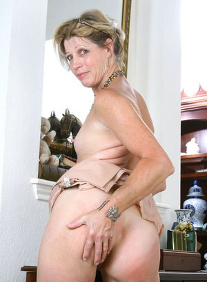Mature businesswoman embarks on a new career as a nude model
