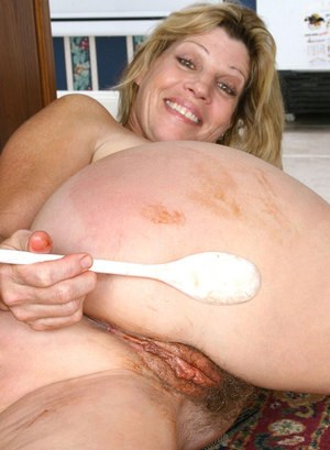 Aged housewife smears chocolate on herself and sticks mixing spoon in her twat