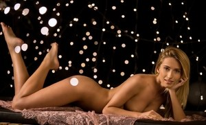 Centerfold model Cara Mell undresses in teasing manner for a Playboy spread