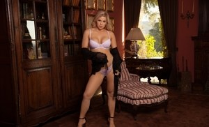 Hot blond chick Laura Alexis removes her bra and panties for centerfold shoot
