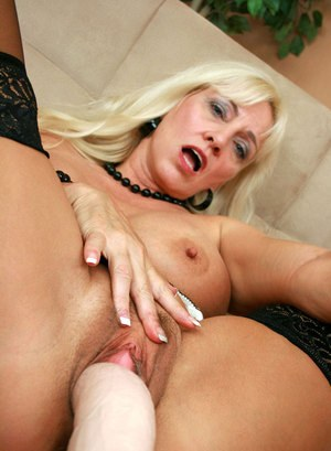 Older blonde woman Cala Craves pleasures herself with a sex machine