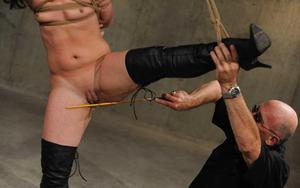 Chubby female endures a painful Shibari session and caning