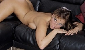 Teen first timer uncovers her nice melons as she gets naked on a leather couch