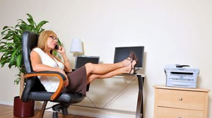 Older businesswoman relives the workday stresses by masturbating