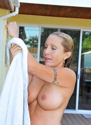 Mature lady removes her bikini for a skinny-dip in the pool
