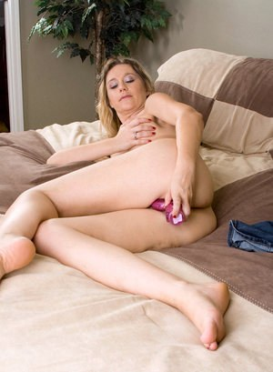 Dirty blonde MILF Nicole Logan works a funky sex toy into her moist vagina