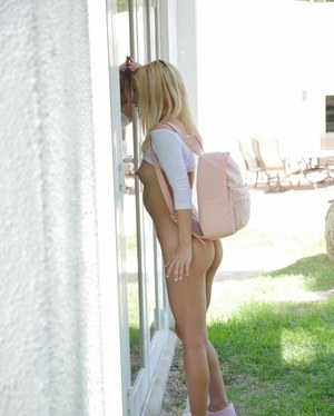 Cute teen girl Kenzie Reeves bares her perky tits and ass to walk across lawn