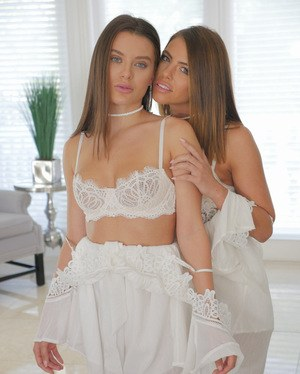 Lesbians Lana Rhoades & Adriana Chechik oil up and eat each others pussy