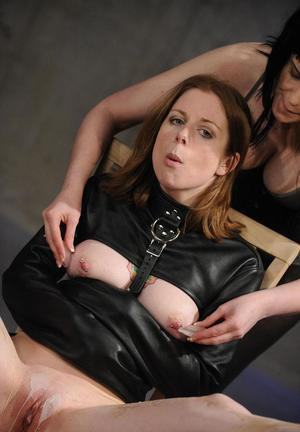 Restrained lesbian is tortured with hot wax before forced masturbation