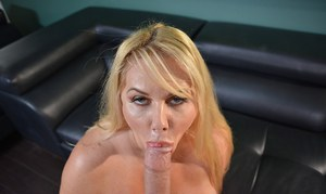 Blonde BBW Karen Fisher is relive of her see thru dress before sucking cock