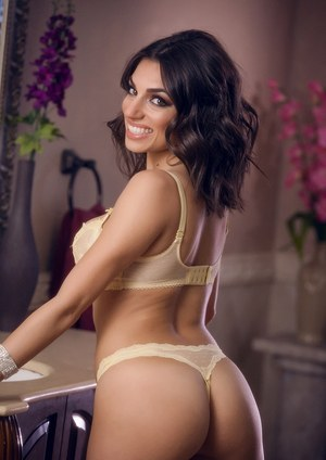 Beautiful brunette model Darcie Dolce removes her sexy bra and panty combo