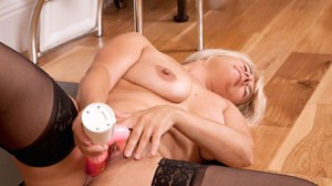 Older lady releases her large tits as undresses to masturbate