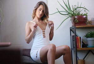 Solo model Uma Jolie removes her white dress for nude posing