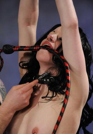 Dark haired female ends up being blindfolded during slave training session