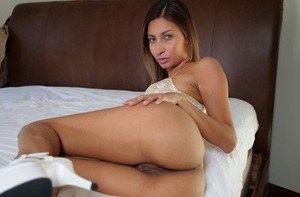 Latina solo girl Jade Jantzen toys her filthy asshole atop her bed sheets