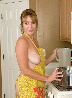 Middle-aged housewife Samantha Stone rides her dildo on kitchen floor