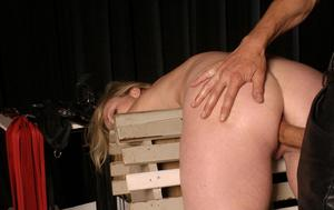 Restrained blonde chick endures anal penetration atop a bondage horse