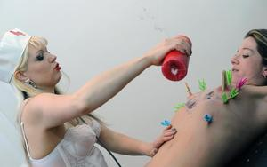 Blond chick in a nurse's cap and lingerie tortures a woman with wax and clamps