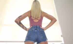 Blonde chick Alex Grey doffs jean shorts and lace panties to display her pussy