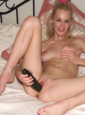 Blonde amateur Phoenix Ray pleasures her pussy with a big cucumber