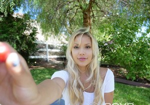 Cute blonde girl Kylie Page unveils her big natural ten boobs in the shade