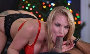 Blonde female Rachael Cavalli gives her black husband a blowjob for Xmas