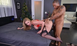Busty blonde chick Rachael Cavalli gets fucked by a black man at Christmas