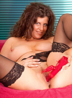 Aged plumper takes a funky sex toy to her horny twat wearing black stockings