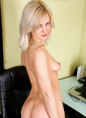 Middle-aged blonde secretary strips to her nylons to masturbate at her desk