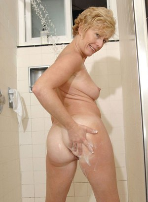 Busty older lady Chanel shows off her hot body in the shower