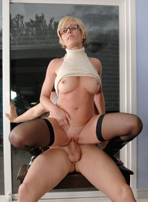 Mature piano teacher seduces her male student in black stocking and boots