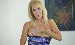 Older woman Erica Lauren lets her tits spill free from her dress