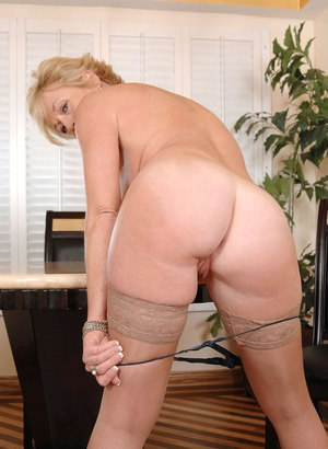 Mature woman strips to flesh colored nylons before toying her bald cunt