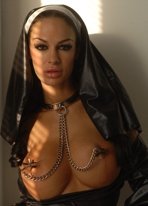 Busty chick Angelina Valentine wears a nun's habit during kinky solo sex
