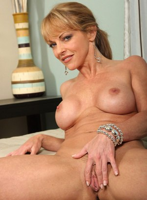Older lady Shayla Laveaux bares her boobs prior to fingering her snatch