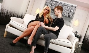 Big titted blonde cougar Alura Jenson teaches a young boy all about sex