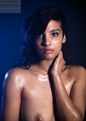 Indian chick shows off her big natural tits while modeling in the nude