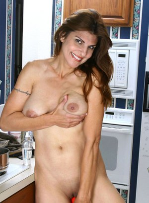 Older woman takes a break from cooking to her suddenly horny vagina