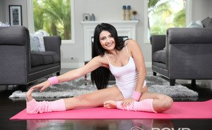 Dark haired solo girl Adria Rae removes her onesie while doing yoga